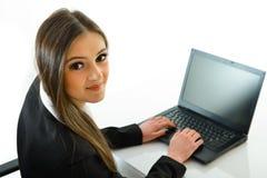 Mulher de negócio no portátil Imagem de Stock Royalty Free