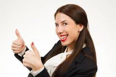 Mulher de negócio nova bonita, com seus polegares acima Fotografia de Stock