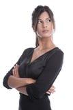 Mulher de negócio nova bonita em um vestido preto isolado Fotografia de Stock Royalty Free