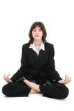 Mulher de negócio nova bonita no terno que Meditating Foto de Stock
