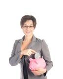 Mulher de negócio nova com banco piggy Fotos de Stock Royalty Free