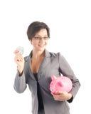 Mulher de negócio nova com banco piggy Imagens de Stock Royalty Free