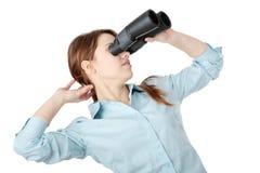 Mulher de negócio nova com binocular Imagens de Stock
