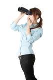 Mulher de negócio nova com binocular Fotografia de Stock