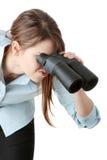 Mulher de negócio nova com binocular Imagem de Stock