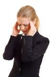 Mulher de negócio nova com dor de cabeça Fotografia de Stock Royalty Free