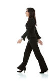 A mulher de negócio nova está andando fotografia de stock