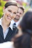 Mulher de negócio ou mulher de negócios Colleagues na equipe Fotografia de Stock Royalty Free