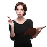 Mulher de negócio pensativa com diário Imagens de Stock