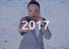 Mulher de negócio pensativa no fundo digitalmente gerado que toca em 2017 Imagem de Stock