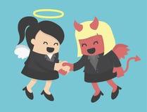 Mulher de negócio que agita demônios da mulher de negócio da mão Fotografia de Stock Royalty Free