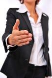 Mulher de negócio que alcanga para um aperto de mão imagens de stock