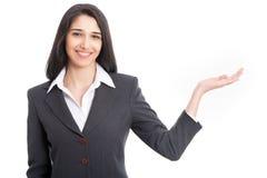 Mulher de negócio que aponta no fundo branco imagens de stock royalty free