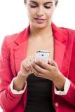 Mulher de negócio que emite sms Foto de Stock Royalty Free