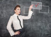 Mulher de negócio que faz a escolha Fotografia de Stock Royalty Free