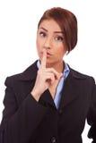Mulher de negócio que faz o gesto quieto Fotografia de Stock Royalty Free