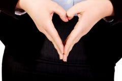 Mulher de negócio que faz uma forma do coração com suas mãos imagem de stock