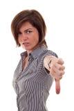 Mulher de negócio que gesticula os polegares para baixo Fotografia de Stock Royalty Free