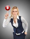 Mulher de negócio que guarda um símbolo da cruz vermelha Fotografia de Stock Royalty Free