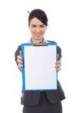 Mulher de negócio que mostra a prancheta fotografia de stock