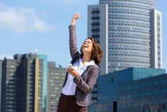 Mulher de negócio que perfura o ar com alegria Imagem de Stock
