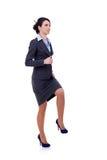 Mulher de negócio que pisa na etapa imaginária Fotos de Stock
