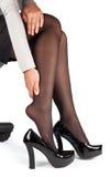 Mulher de negócio que toca em seus pés cansados isolados em um branco Foto de Stock