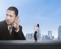 A mulher de negócio que usa o megafone diz algo dirigir Imagens de Stock Royalty Free
