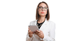 Mulher de negócio 'sexy' com vidros com a tabuleta em um fundo branco Imagem de Stock
