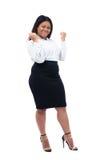 Mulher de negócios africana que comemora seu vencedor Imagem de Stock