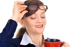 Mulher de negócios atrativa que aprecia o café Fotografia de Stock Royalty Free