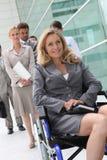 Mulher de negócios bem sucedida na cadeira de rodas imagens de stock royalty free