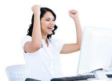 Mulher de negócios bem sucedida que perfura o ar Imagens de Stock Royalty Free