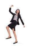 Mulher de negócios bem sucedida que salta, corpo completo fotografia de stock