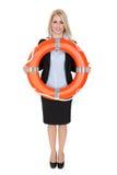 Mulher de negócios bonita com bóia de vida Imagem de Stock