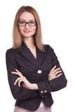 A mulher de negócios bonita com braço dobrou os vidros vestindo isolados Foto de Stock