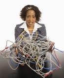 Mulher de negócios com cabos do computador. Imagens de Stock Royalty Free