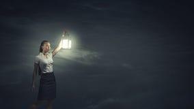 Mulher de negócios com lanterna Fotografia de Stock