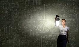 Mulher de negócios com lanterna Imagem de Stock Royalty Free