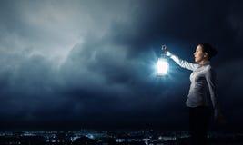 Mulher de negócios com lanterna Fotografia de Stock Royalty Free