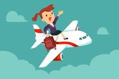 A mulher de negócios com mala de viagem senta-se sobre o avião Fotos de Stock Royalty Free