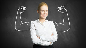 Mulher de negócios com o desenho que simboliza o poder Fotografia de Stock