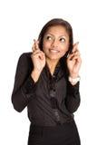 Mulher de negócios com os dedos de ambas as mãos cruzadas imagens de stock royalty free