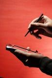 Mulher de negócios com PDA Fotos de Stock Royalty Free
