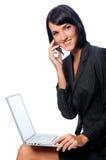 Mulher de negócios com portátil e telefone foto de stock