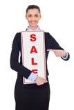 Mulher de negócios com sinal da venda Imagem de Stock