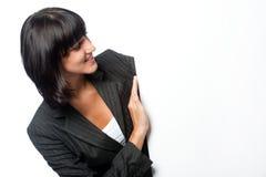 Mulher de negócios com um cartão em branco imagem de stock