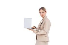 Mulher de negócios com um portátil Fotos de Stock