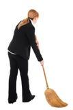 Mulher de negócios com vassoura Imagem de Stock