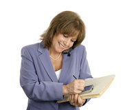 Mulher de negócios confiável Multitasks Foto de Stock Royalty Free